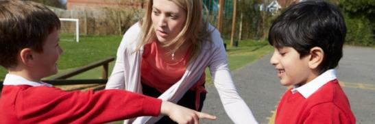 teacher-stopping-bullying-in-playground