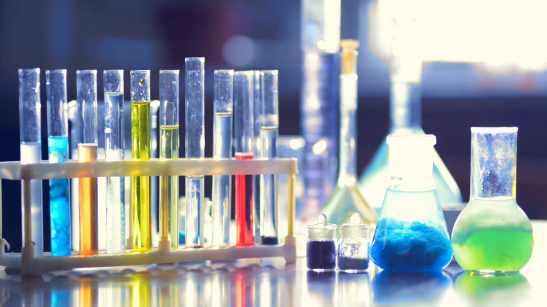 test-tubes-flasks-beakers-with-colored-reagents-in-a-chemical-laboratory-blurred-background-filmed-on-telephoto-lens_h5ozyoa__F0000.png