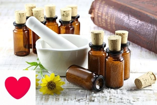 homeopathic arnica pills in brown glass bottles on wooden table